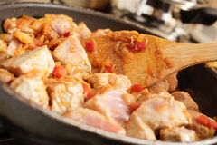 Pork in frying pan Stock Images