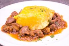 Pork goulash with egg on rice Royalty Free Stock Photo