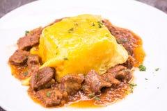 Pork goulash with egg on rice Stock Photos