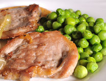 Pork and green peas Royalty Free Stock Images