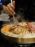 Pork grill on BBQ brass pan stock photography