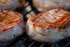 Pork on the grill Stock Photos