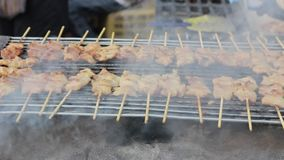 Pork grill over coals sold in thai market. Royalty Free Stock Photo