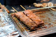 Pork grilled on tray. In street food Royalty Free Stock Images