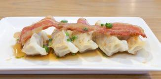Pork gyoza. With a bacon royalty free stock photos