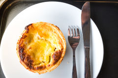 Pork Ham Quiche. Served on white dish with fork and knife Stock Photos