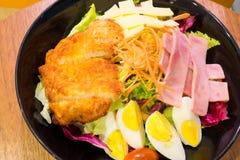Pork and ham salad. Pork and ham sald on the black dish Royalty Free Stock Photography