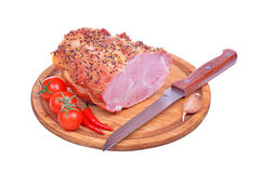 Pork ham, tomatoes, peppers, garlic and knife isolated on white Royalty Free Stock Photos
