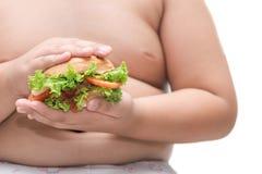 Pork hamburger on obese fat boy hand background isolated Stock Photography