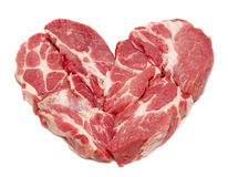 Pork heart isolated on white. Pork meat in heart form isolated on white background Royalty Free Stock Photo