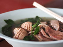Pork internal hot clear soup with blood jelly THAI and CHINESE menu. Pork internal hot clear soup with blood jelly THAI and CHINESE herbal vegetable mixed in a Stock Image