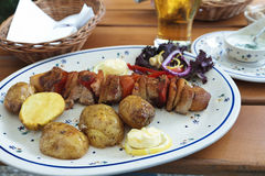Pork kebab and potatoes Royalty Free Stock Image