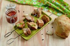 Pork kebab with tomato sauce Royalty Free Stock Photo