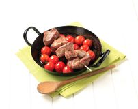 Pork kebab and tomatoes Royalty Free Stock Image