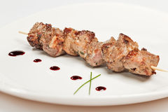 Pork kebab on white plate. With sauce Stock Image