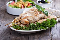 Pork kebabs with fresh salad leaves Royalty Free Stock Images