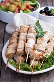 Pork kebabs with fresh salad leaves Royalty Free Stock Photos