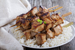 Pork kebabs in soy sauce. With rice stock photography