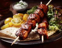 Pork kebabs with tortilla and salad Royalty Free Stock Images