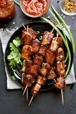 Pork kebabs on wooden skewers Royalty Free Stock Image