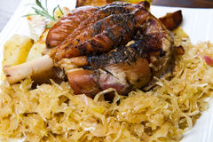Pork knuckle baked with  sauerkraut Royalty Free Stock Image