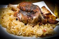 Pork knuckle baked with  sauerkraut Stock Photos