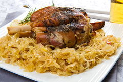 Pork knuckle baked with  sauerkraut Stock Photography