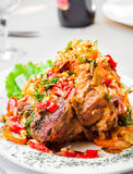 Pork knuckle baked with vegetables, meat Royalty Free Stock Photos
