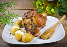 Pork knuckle and beer. Roasted pork knuckle. Ham and bacon are popular foods in the west, and their consumption has increased with industrialisation Stock Photos