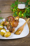 Pork knuckle and beer. Roasted pork knuckle. Ham and bacon are popular foods in the west, and their consumption has increased with industrialisation Royalty Free Stock Images