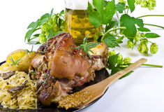 Pork knuckle and beer. Roasted pork knuckle. Ham and bacon are popular foods in the west, and their consumption has increased with industrialisation Stock Image