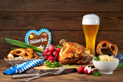 Pork knuckle with beer and sauerkraut Stock Images