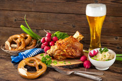 Pork knuckle with beer and sauerkraut Stock Image
