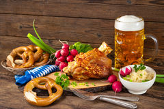 Pork knuckle with beer and sauerkraut Royalty Free Stock Photo