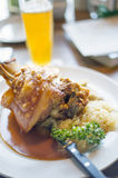 Pork knuckle and beer Stock Images