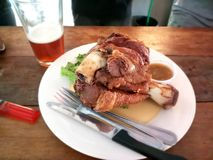 Pork knuckle or Deep fried pork leg with craft beer royalty free stock photo