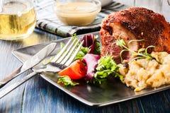 Pork knuckle with fried sauerkraut Stock Photos