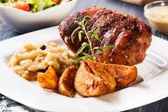 Pork knuckle with fried sauerkraut Royalty Free Stock Photo