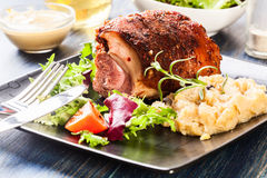 Pork knuckle with fried sauerkraut Royalty Free Stock Photography
