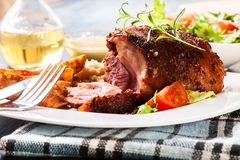 Pork knuckle with fried sauerkraut Royalty Free Stock Images