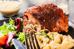 Pork knuckle with fried sauerkraut. And salad Stock Images