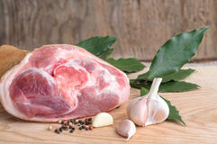 Pork knuckle with pepper garlic and bay leaves Raw uncooked. The Pork knuckle with pepper garlic and bay leaves Raw uncooked Stock Images