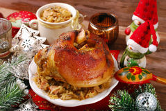 Pork knuckle with sauerkraut for christmas dinner. Roasted pork knuckle served with bigos (sauerkraut ) for christmas dinner Stock Photography