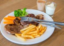 Pork Kuroda Ta Boo. Pork steak with sauce Kuroda Abu Ta 2 colors Royalty Free Stock Images