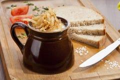 Pork lard in the pot and dark bread Stock Photos