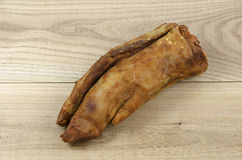 Pork leg on elm wood. Pork leg marinade over elm wood background royalty free stock photography