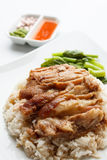 Pork leg with rice isolated on white background. Pork leg with rice and sauce isolated on white background Stock Photography