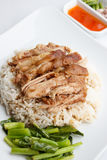 Pork leg with rice on white background. Pork leg with rice and sauce on white background stock photos