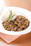 Pork liver with rosemary and rice Stock Photos