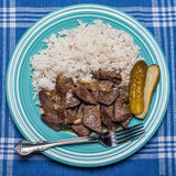 Pork livers with onion pickles and rice Stock Photography
